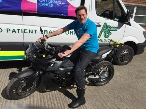 Bus firm boss goes from four wheels to two for European charity tour